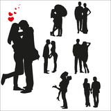 Vector silhouettes of loving couples Royalty Free Stock Image