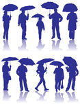 Vector Silhouettes Man, Women And Child With Umbrella Royalty Free Stock Photography