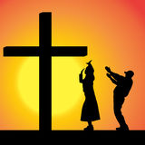 Vector silhouettes of people. Vector silhouettes of people at the Cross at sunset Stock Image