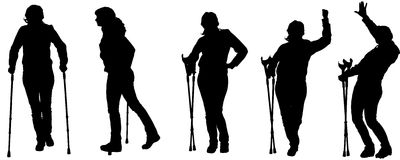 Vector silhouettes of people with crutches. Stock Photos