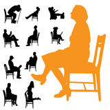 Vector silhouettes of people. Vector silhouettes of people sitting in a chair Royalty Free Stock Images
