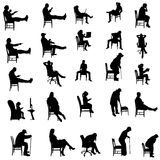 Vector silhouettes of people. Vector silhouettes of people sitting in a chair Stock Photo
