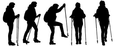 Vector silhouettes of people with trekking stick. Stock Photography