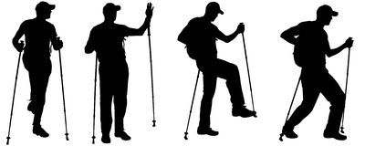 Vector silhouettes of people with trekking stick. Royalty Free Stock Photo