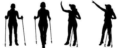 Vector silhouettes of people with trekking stick. Stock Photo