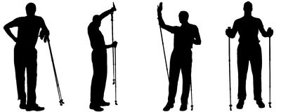 Vector silhouettes of people with trekking stick. Stock Image