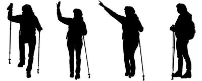 Vector silhouettes of people with trekking stick. Stock Images