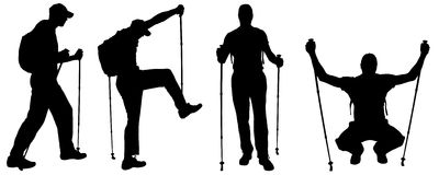Vector silhouettes of people with trekking stick. Stock Photos