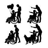 Vector silhouettes of people in a wheelchair. Stock Photo