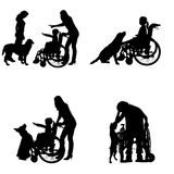 Vector silhouettes of people in a wheelchair. Royalty Free Stock Photo