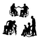 Vector silhouettes of people in a wheelchair. Vector silhouettes of people in a wheelchair on a white background stock illustration