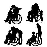 Vector silhouettes of people in a wheelchair. Vector silhouettes of people in a wheelchair on a white background Stock Photo