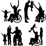 Vector silhouettes of people in a wheelchair. Stock Photography