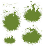 Vector silhouettes rabbits in grass. Royalty Free Stock Photo