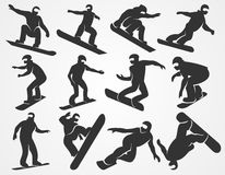 Vector silhouettes of snowboarders Royalty Free Stock Images