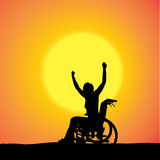 Vector silhouettes of woman in a wheelchair. Stock Image