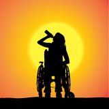 Vector silhouettes of woman in a wheelchair. Royalty Free Stock Photo