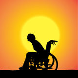 Vector silhouettes of woman in a wheelchair. Stock Images