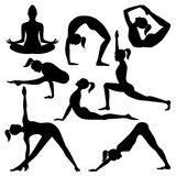 Vector silhouettes of yoga positions. Isolated on a white background Stock Photography