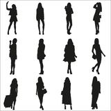 Vector silhouettes of the young girls Stock Photography