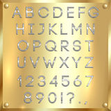 Vector silver coated alphabet letters, digits and punctuation on gold background Stock Photo