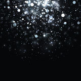 Vector silver glowing light glitter background. Christmas white magic lights background. Star burst with sparkles on black background Royalty Free Stock Photos