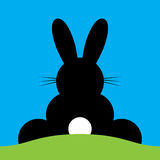 Vector sitting back Easter bunny Stock Photos