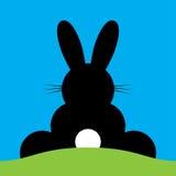 Vector sitting back Easter bunny Stock Photos