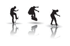 Vector of skateboarders in silhouettes Stock Photography