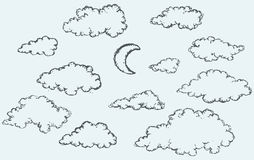 Vector sketch. Clouds and crescent Stock Photos