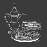 Vector sketch drawing chalk on blackboard ethnic Arabic cup and copper coffeepot, big plate East sweets. Illustration. Black and white items of the coffee Stock Photos