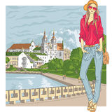 Vector sketch of a fashion stylish girl in the old city. Vector sketch of a fashion stylish girl in jeans, jacket, cap with glasses and bag in the old city stock illustration