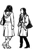 Vector sketch of two women friends in coat standing talking Royalty Free Stock Images