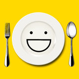 Vector of smile face draw on white plate Royalty Free Stock Photo