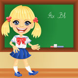 Vector smiling schoolgirl near blackboard royalty free stock image