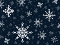 Vector snowflakes on a blue background Royalty Free Stock Image