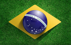 Vector soccer ball with brazilian flag. Soccer ball with brazilian flag on soccer field, Vector illustration modern design template Royalty Free Stock Images