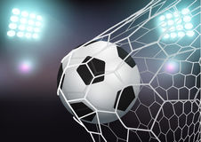 Vector soccer ball in the goal net on stadium Stock Photos