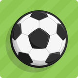Vector soccer ball. Vector illustration of a soccer ball on a green lawn Royalty Free Stock Image