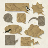 Vector speech bubbles with old folded paper texture Stock Images