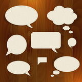 Vector speech paper bubble on wood background Royalty Free Stock Image