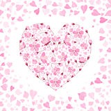 Vector spring background with gentle heart from cherry flowers and petals, on the white background Stock Photos