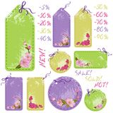 Vector spring sale tags with cherry flowers Stock Photos