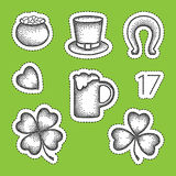 Vector St. Patrick day patch badges in dotwork style. Dotted lucky clover or shamrock, pot of coins, beer, horseshoe and hat. Royalty Free Stock Photos