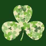 Vector St Patrick's day card. Green and white clover leaves on clover leaf shape and dark background Royalty Free Stock Image