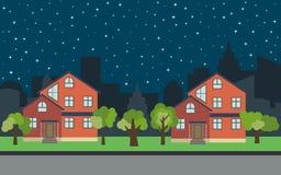 Vector Stadt mit zwei zweistöckigen Karikaturhäusern und grünen Bäumen nachts Stockfotografie