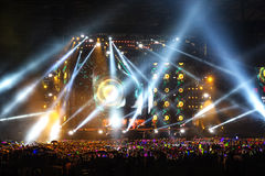Vector Stage Spotlight with Laser rays in the night Stock Images
