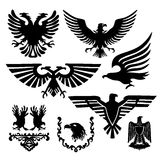 Coat of arms with an eagle. Vector stamp collection black eagles Royalty Free Stock Photos