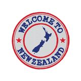 Vector stamp of welcome to New Zealand with map outline of the nation in center. royalty free stock images