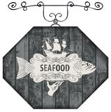 Signboard for seafood with fish and sailboat. Vector street sign or banner for seafood restaurant or shop with a picture of a hand with a tray on which is a big Stock Photo